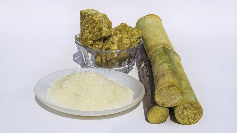 St?cke des Zuckerrohrs mit raffiniertem Zucker lizenzfreies stockbild