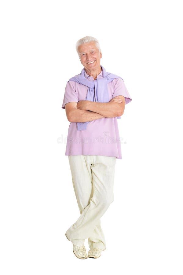 St?ende av den lyckliga h?ga mannen som poserar p? vit bakgrund royaltyfri foto