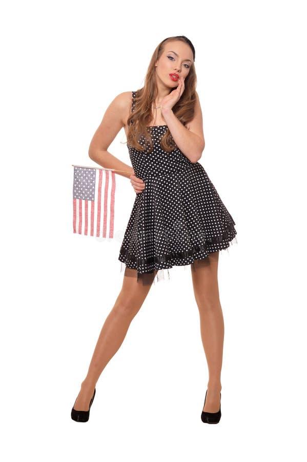 St?enden av den unga kvinnan som poserar med flaggan av USA, isolerade arkivfoton
