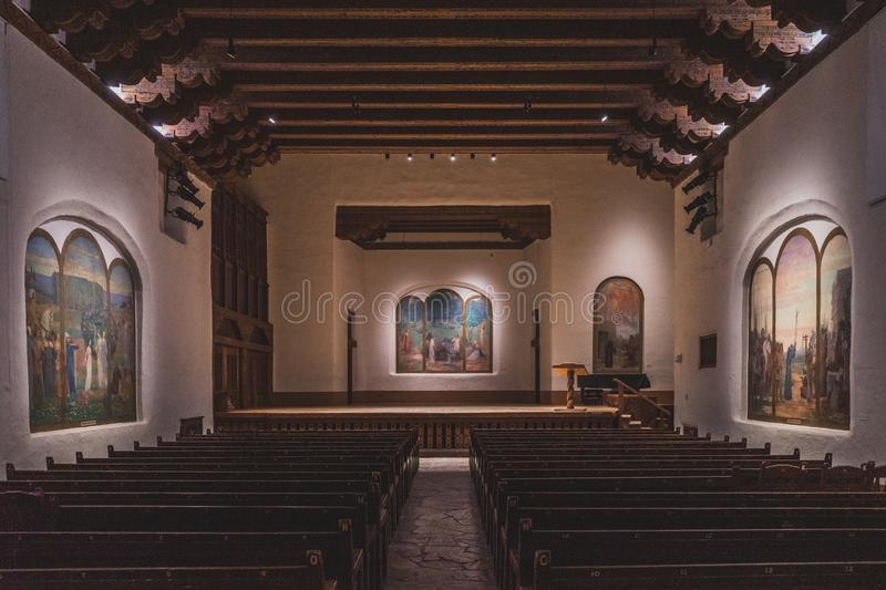 St. Francis Auditorium at New Mexico Museum of Art. April 2, 2019: Santa Fe, New Mexico, USA: St. Francis Auditorium with murals inside New Mexico Museum of Art stock image