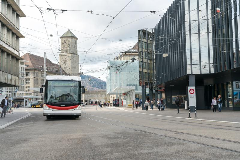 St. Gallen, SG / Switzerland - April 8, 2019: Sankt Gallen train station and local buses and commuter trains leaving the public stock image