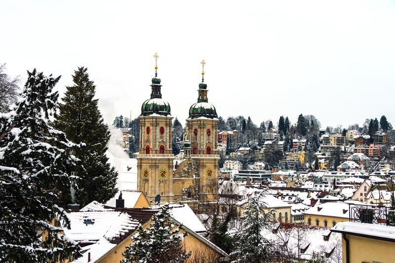 Covered in snow Cathedral in St Gallen, Switzerland. St Gallen, Switzerland. Aerial view of historical buildings covered in snow in winter. Cathedral in St royalty free stock images