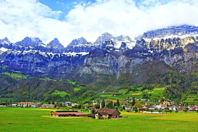 St Gallen Switzerland landscape. Village on green spring valley on the foot of Alps mountains, Walenstad St. Gallen Switzerland royalty free stock photography