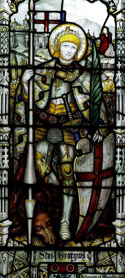 St. George с драконом в цветном стекле стоковая фотография