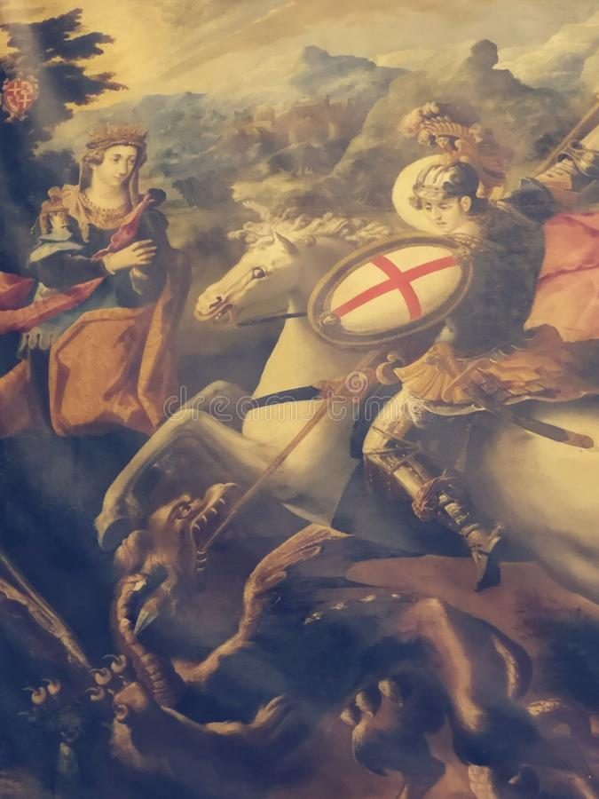 St George conquering the dragon by Francesco Potenzano in St John's Co Cathedral, Malta. St George slaying the dragon, painting by Francesco Potenzano royalty free stock photos