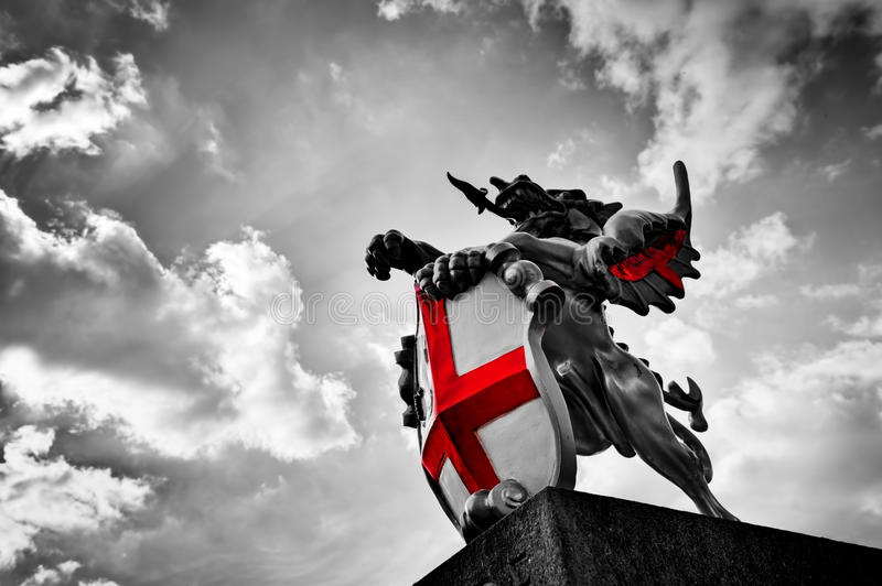 St George dragon statue in London, the UK. Black and white, red flag, shield. St George dragon statue in London, the UK. Symbol of England. Black and white with stock images