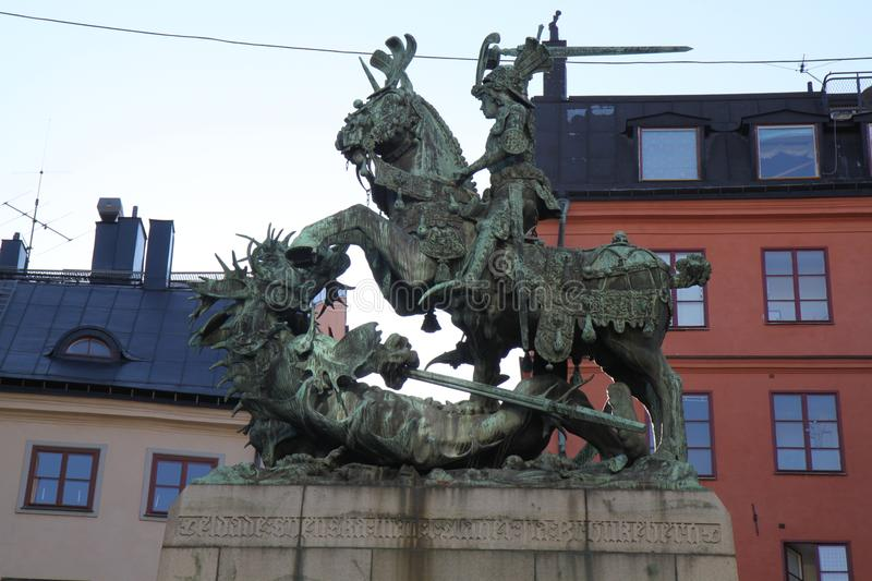 St. George and the Dragon on Stockholm. A picture of a statue of St. George and the Dragon in the old town of Gamla Stan in Stockholm, Sweden with a view of stock photo