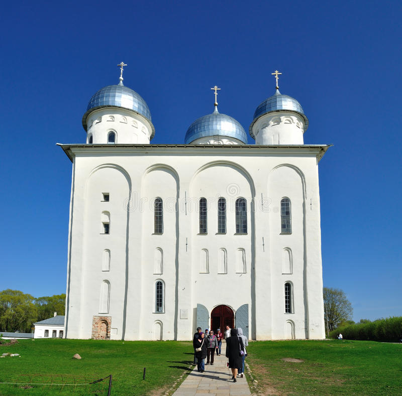 St. George's Cathedral. VELIKY NOVGOROD, RUSSIA - MAY 10. 2015. Parishioners at St. George's Cathedral in Russian orthodox Yuriev Monastery in spring sunny day stock images