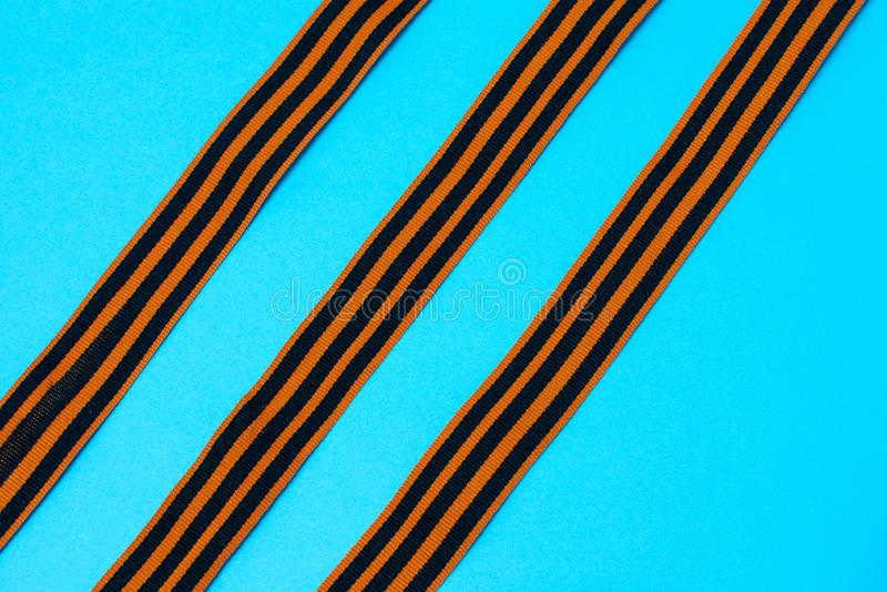 St. George`s ribbon on blue background. The symbol of the great victory of May 9 royalty free stock photography