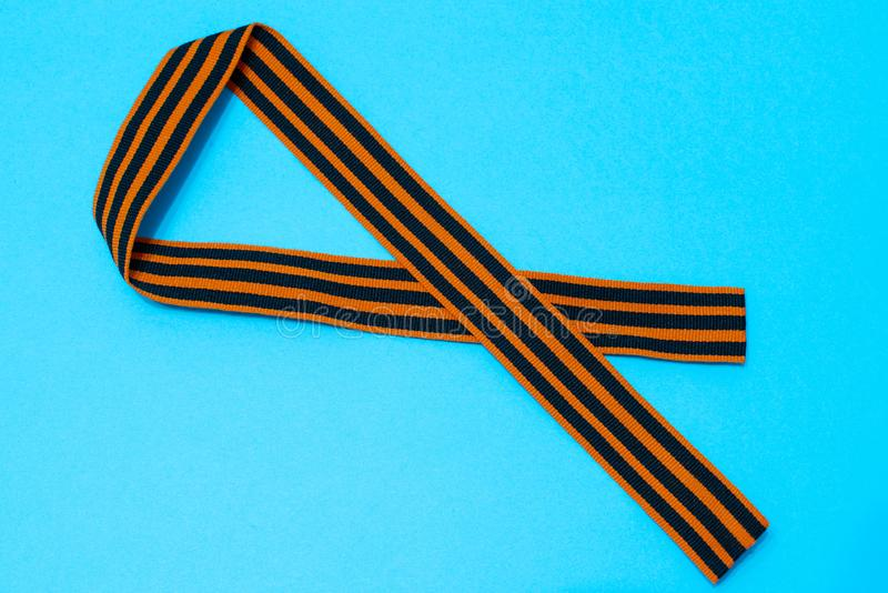 St. George`s ribbon on blue background. The symbol of the great victory of May 9 royalty free stock images