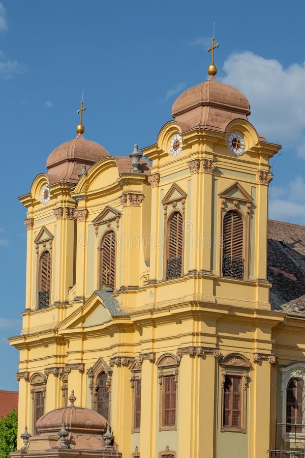 St. George's Roman Catholic Cathedral Façade in Union Square Timisoara. Close-up Detail on the Roman Catholic Cathedral Bell Towers in Union Square in stock photos