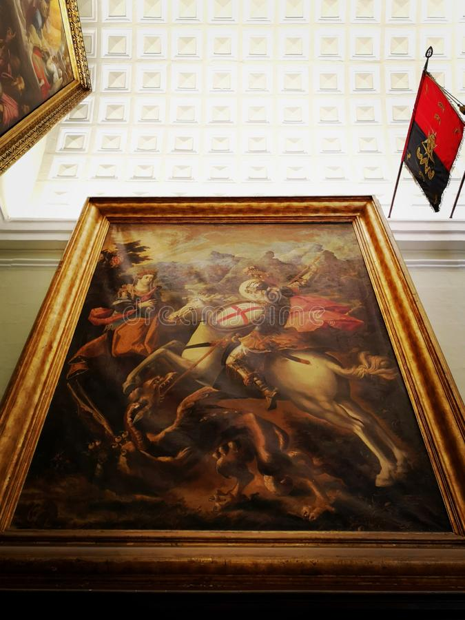 St George conquering the dragon by Francesco Potenzano in St John& x27;s Co Cathedral, Malta. St George slaying the dragon, painting by Francesco Potenzano stock image