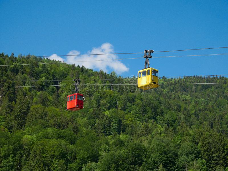St Gilgen/Austria - June 2 2019: red and yellow tourist cable cars in austria royalty free stock photography