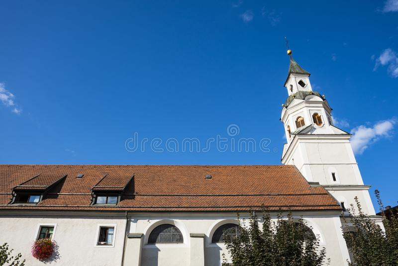 St Gotthard and St Erhard church, Bressanone Brixen, italy. White tower of St Erhard church Brixen Bressanone, Italy. Sunny day and blue sky royalty free stock photo