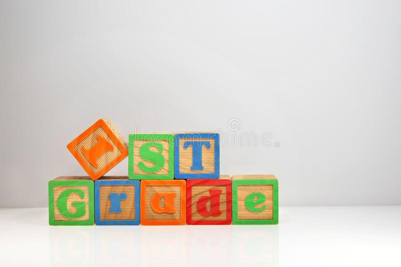 1st Grade spelled out with ABC blocks royalty free stock image