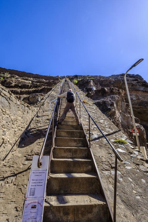 Jacobs Ladder photographer St Helena. ST HELENA ISLAND, SOUTH ATLANTIC - APRIL 2 2018: Photographer stands astride the 699 steps of Jacobs Ladder in Jamestown royalty free stock photography