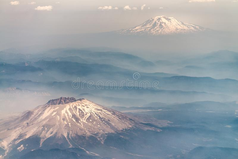 St Helens Volcano and Mount Adams from airplane stock image