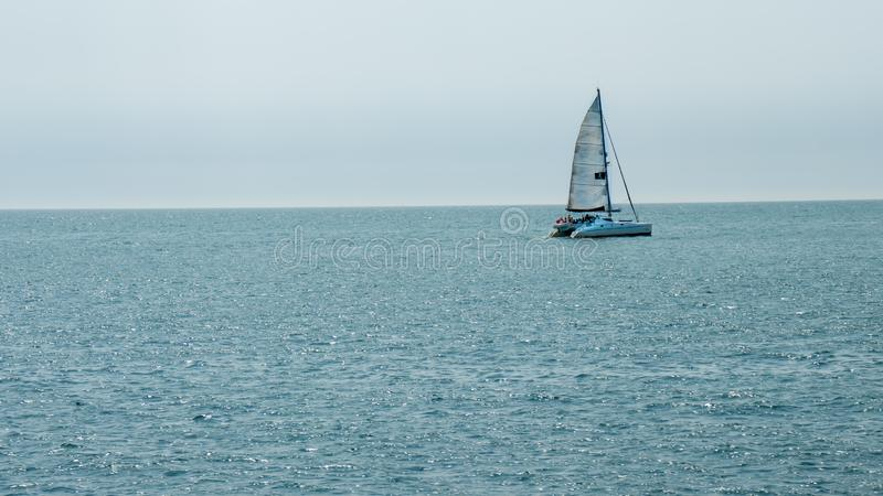 Catamaran carrying tourists near St Hellier. St Helier, United Kingdom, - 07, 25, 2019: view from the sea of a catamaran carrying tourists stock images