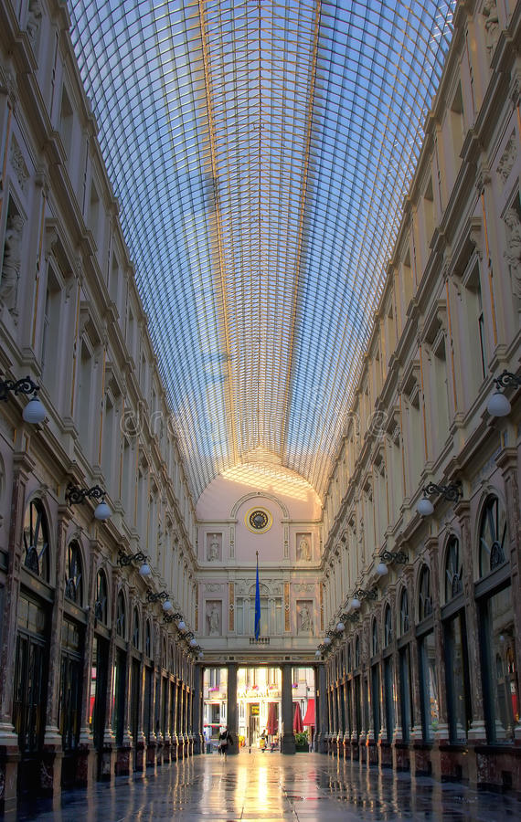 St Hubert Gallery. Famous luxuous shopping mall in Brussels, Belgium, the Galeries St Hubert, with characteristic symmetrical shot stock photos