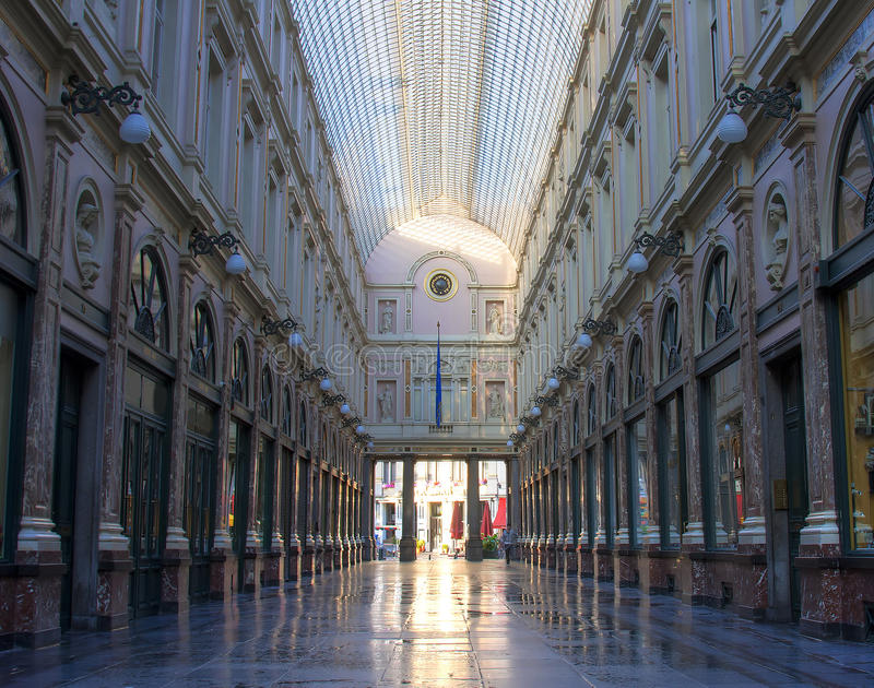 St Hubert Gallery. Famous luxuous shopping mall in Brussels, Belgium, the Galeries St Hubert, with characteristic symmetrical shot royalty free stock photography