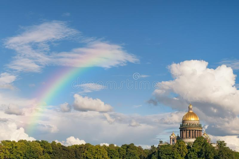St. Isaak cathedral panoramic view with clouds and rainbow stock image
