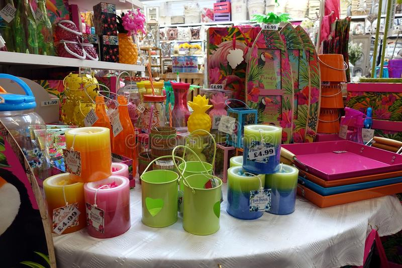 St Ives, Cornwall, UK - April 13 2018: Colourful homeware and decorative items for sale on shelves in a fancy goods store royalty free stock image