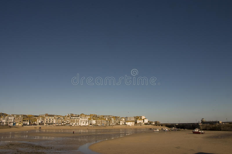St. Ives harbour. Deep blue sky above St. Ives harbour, early morning stock image