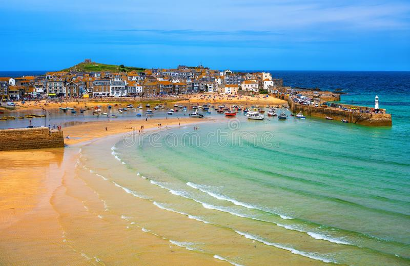 St Ives, a popular seaside town and port in Cornwall, England. Picturesque St Ives, a popular seaside town with golden sand beach in Cornwall, England royalty free stock images