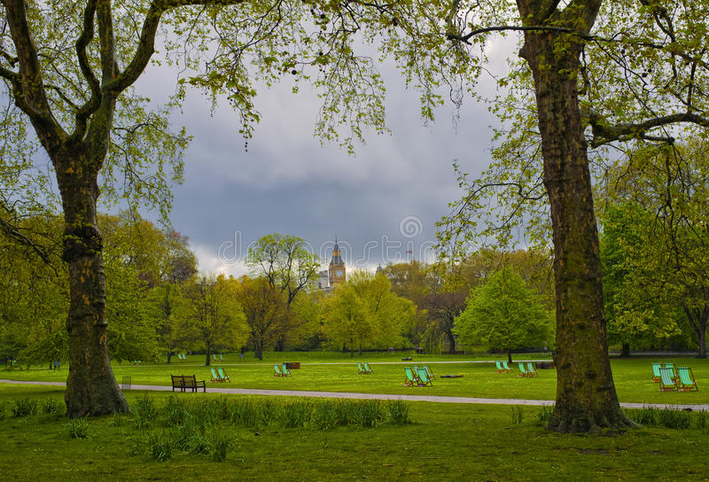 St. James Park, London, England. St. James Park, a large open green space with a lake, trees, and grass, next to Buckingham Palace, London, England, is quiet and stock image