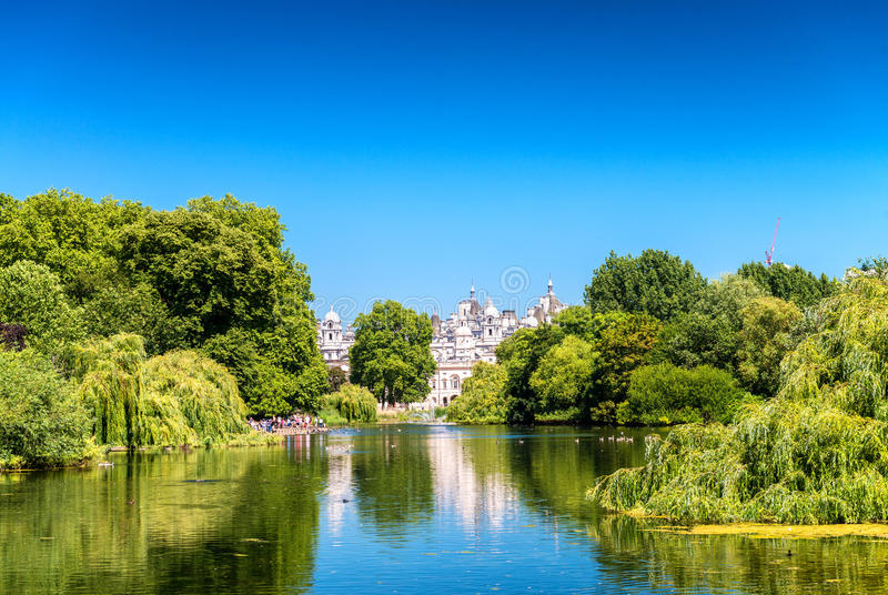 St James's Park London UK, with buildings, trees and lake.  stock image