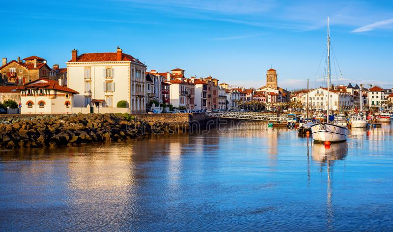 St Jean de Luz Old Town and port, Basque country, France. Traditional white houses in St Jean de Luz Old Town and port, Basque country, France, in sunset light royalty free stock images