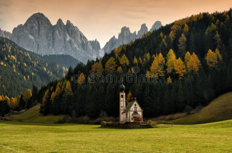 St. Johann San Giovanni in Italian Chapel in Val di Funes with the Dolomites Odle group on background. stock photo