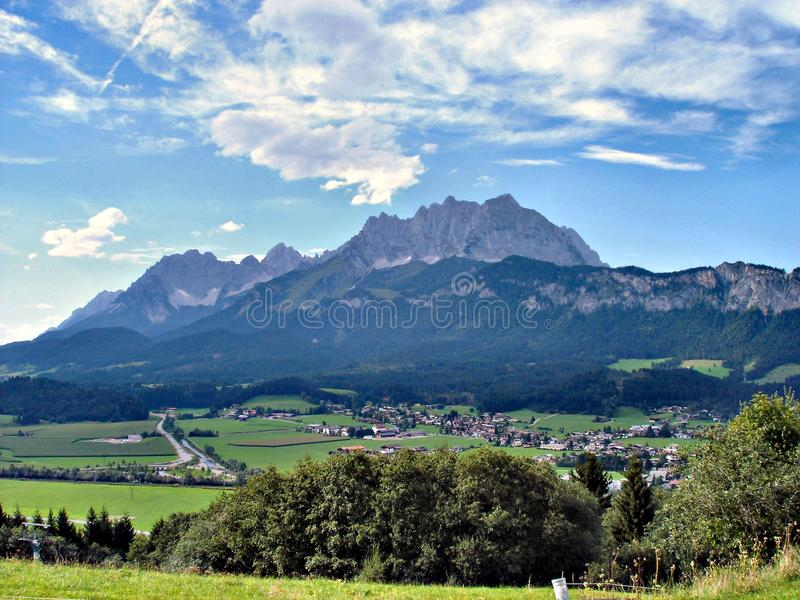 St. Johann in Tyrol and the Wilder Kaiser. St. Johann in Tirol is a market town in Tyrol, Austria, in the Kitzbühel district. St. Johann lies in a valley stock images