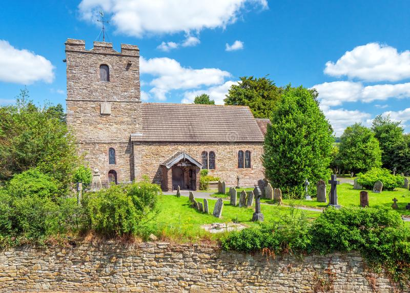 St John the Baptist Church, Stokesay, Shropshire, England. St John the Baptist Church on a sunny summers day as seen from within the walls of Stokesay Castle in royalty free stock photography