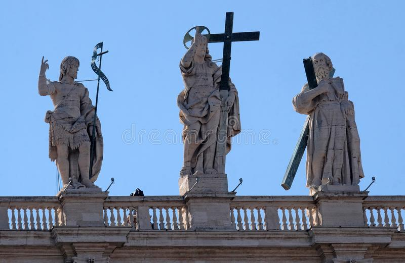 St. John the Baptist, Jesus, St. Andrew. Fragment of colonnade of St. Peters Basilica. Papal Basilica of St. Peter in Vatican - the world largest church, is royalty free stock photo