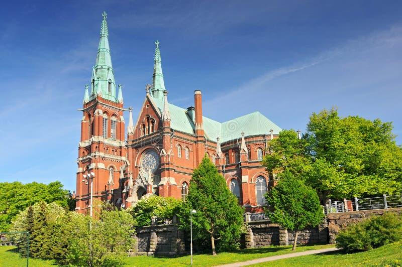 St John's Church i Helsingfors, Finland är en lutheransk kyrka som har utformats av den svenska arkitekten Adolf Melander i Gothi royaltyfri foto