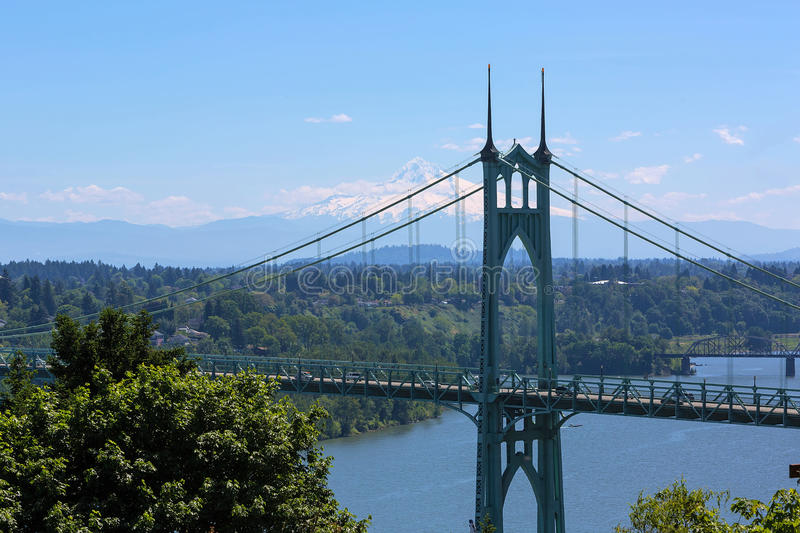 St Johns Bridge and Mount Hood. On a beautiful blue sky sunny day royalty free stock image