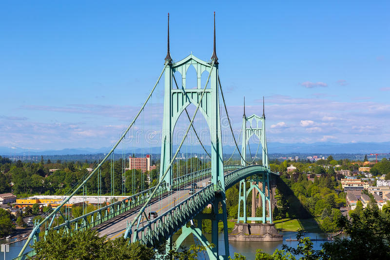 St Johns Bridge over Willamette River in Portland Oregon. St Johns Bridge over Willamette River and Cathedral Park in Portland Oregon on a blue sky sunny day royalty free stock image