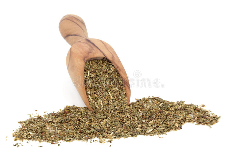 St Johns Wort Herb. In an olive wood scoop over white background. Used in alternative medicine to treat depression stock images
