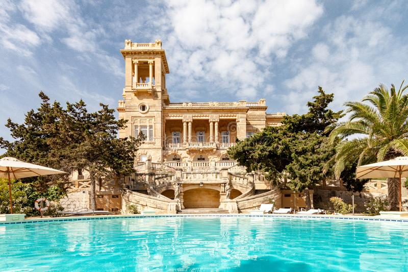 St. Julian's, Malta. 1920s art nouveau mansion Villa Rosa built in park in St. Julian's town by architect Andrea royalty free stock photography