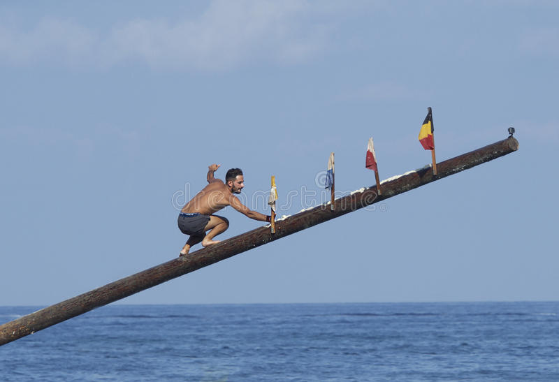 ST JULIANS, MALTA - sep 8: national traditional popular game Gonstra, summer challenge in Malta running on pole trying retrieve fl stock photography