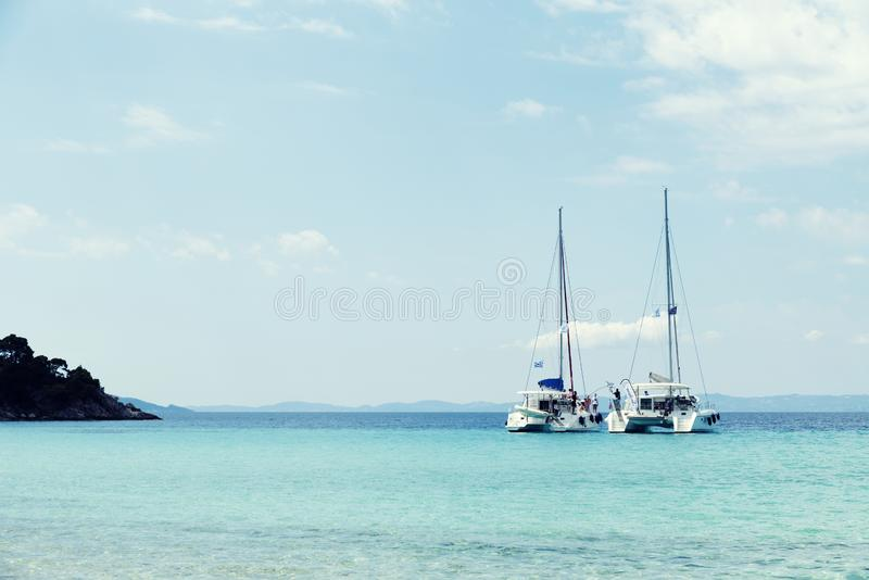 1st June 2019 Party boats in Kalogria bay Greece Sithonia Halkidiki. Selective focus stock image