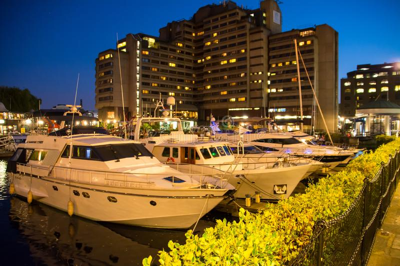 St Katharine dock in London at night, UK. Modern yacht and boat pier royalty free stock photo