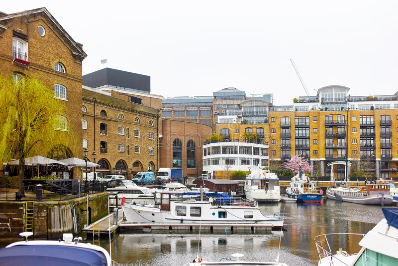 St Katharine Docks in London. London, United Kingdom - APRIL 10, 2018: Buildings and yachts in St Katharine Docks royalty free stock image