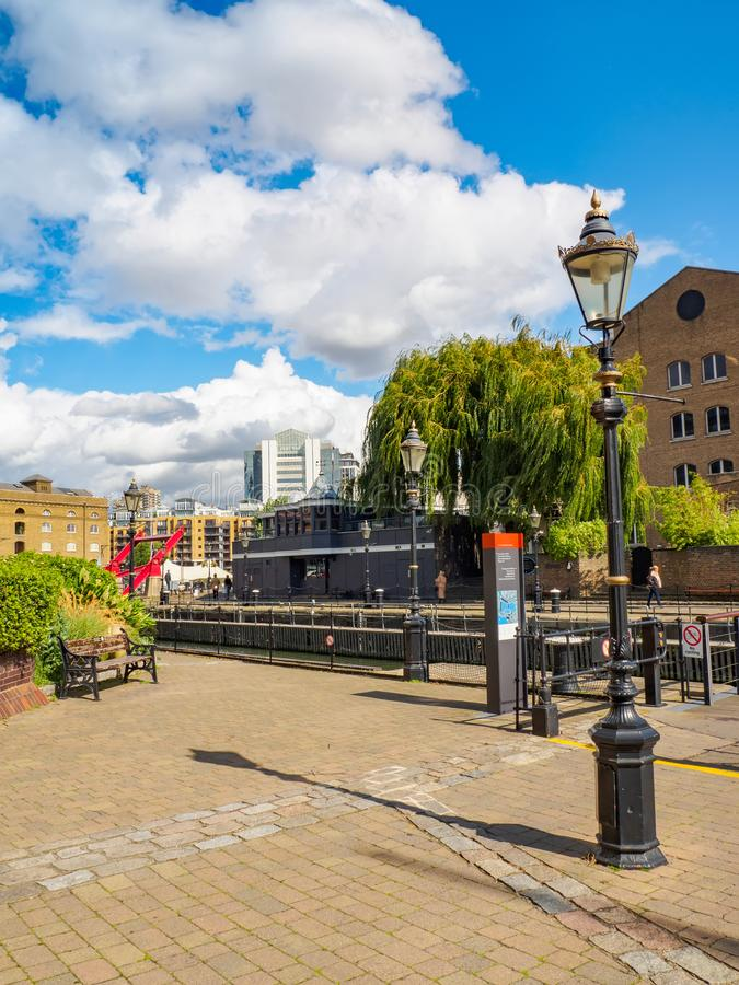 St. Katharine Docks - a quarter and marina next to the Tower of London and Tower Bridge on a sunny day. royalty free stock image
