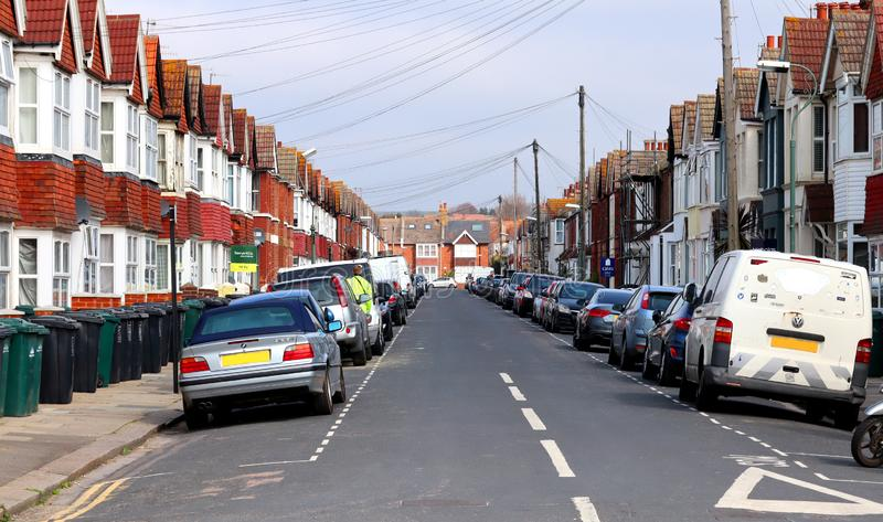 St Leonards Avenue in Hove, East Sussex. A view from the St Leonards Avenue, a street in Hove, Sussex, England, full of tightly packed terraced houses stock image
