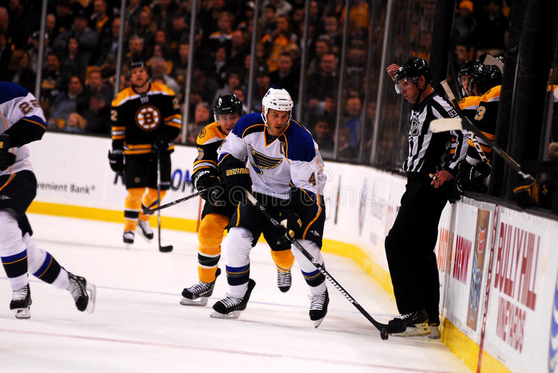 St. Louis Blues Captain Eric Brewer. Takes the puck up the ice against the Boston Bruins royalty free stock image