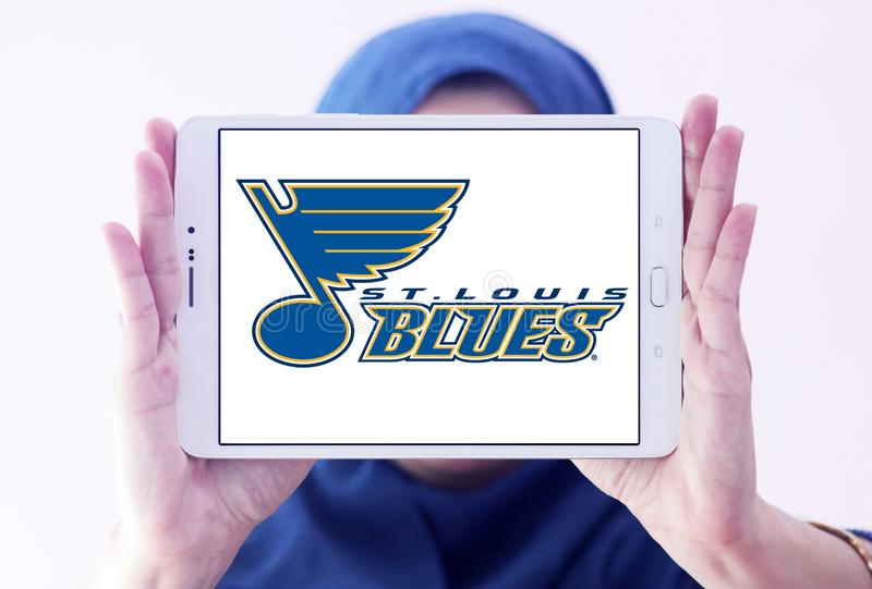 St. Louis Blues ice hockey team logo. Logo of St. Louis Blues ice hockey team on samsung tablet holded by arab muslim woman. The St. Louis Blues are a royalty free stock image