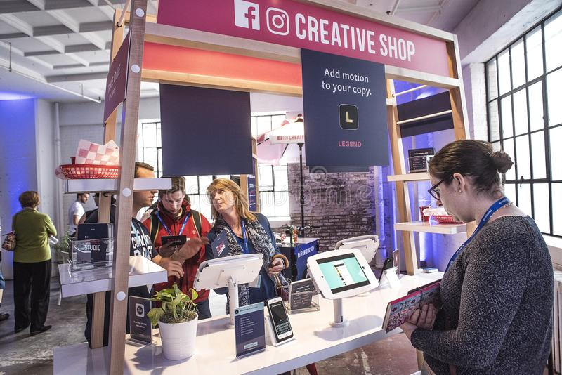 St Louis, Missouri, United States-March 27 2018-Facebook Community Boost event people at the mobile phone Creative Shop kiosk. St Louis, Missouri, United States royalty free stock image