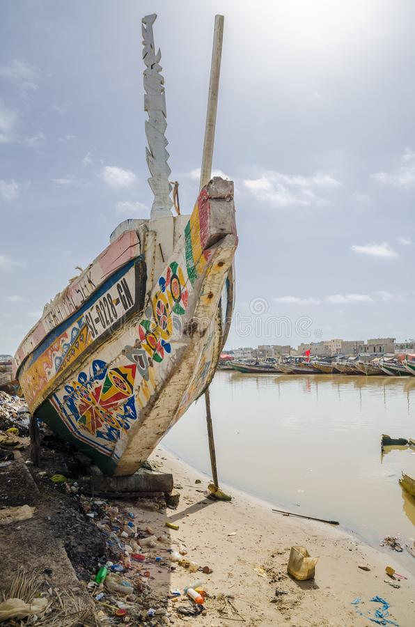 St Louis, Senegal - October 12, 2014: Colorful painted wooden fishing boats or pirogues at coast of St. Louis royalty free stock photos